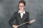 Strict teacher with wooden stick